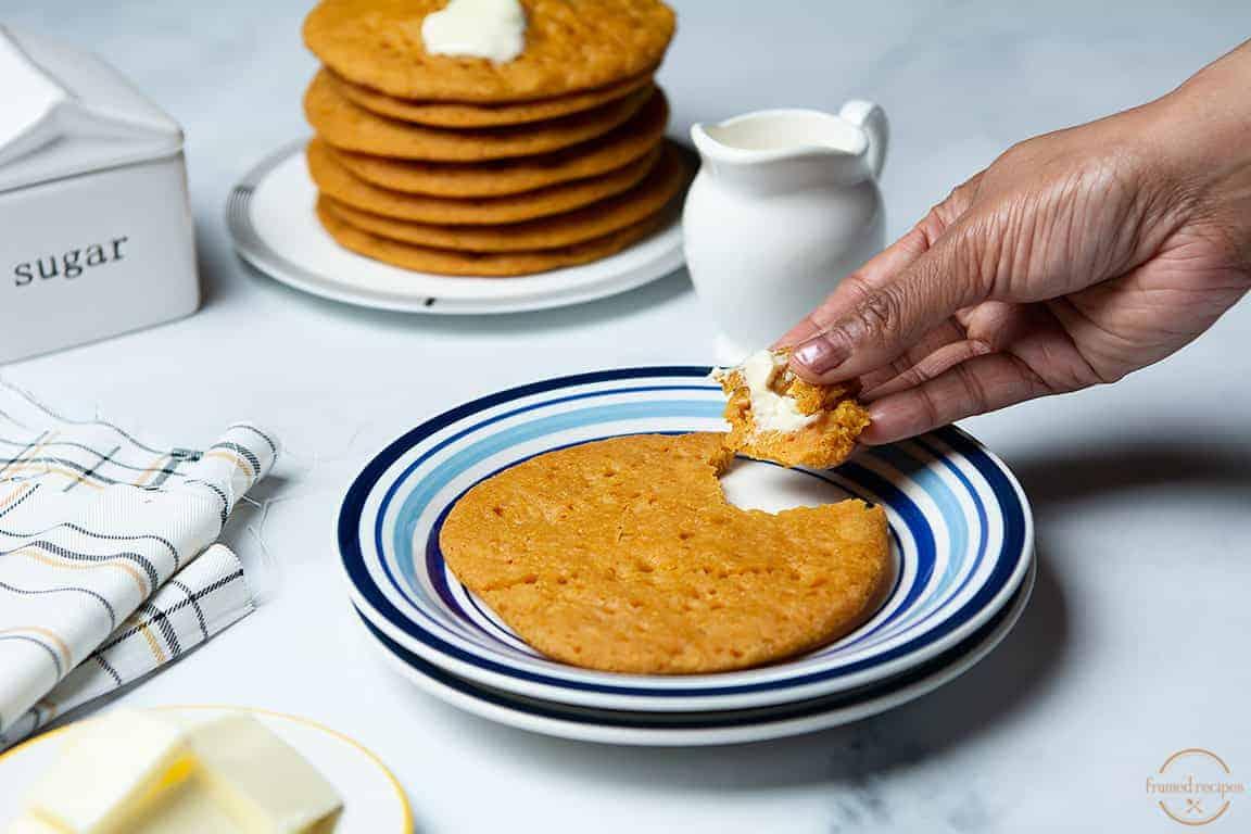 taking a bite of gluten free pumpkin pancakes.