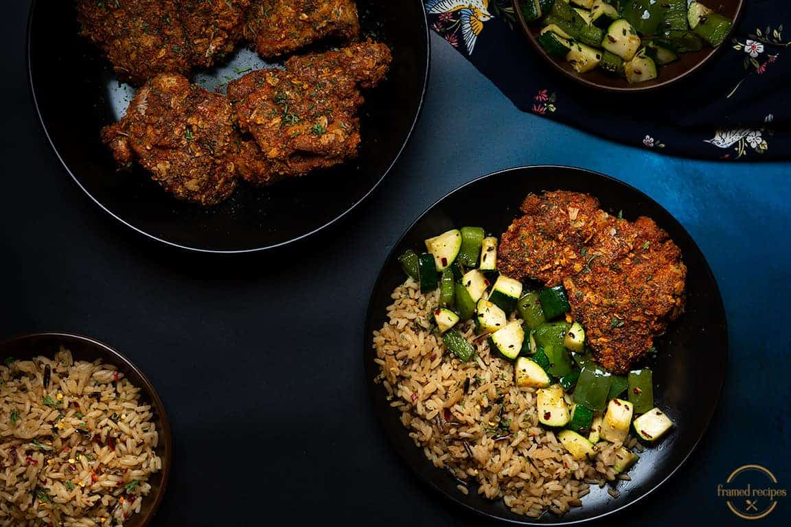Spicy_Oats_Crusted_Chicken_Thighs_serving_suggestion_of_vegetables_and_rice