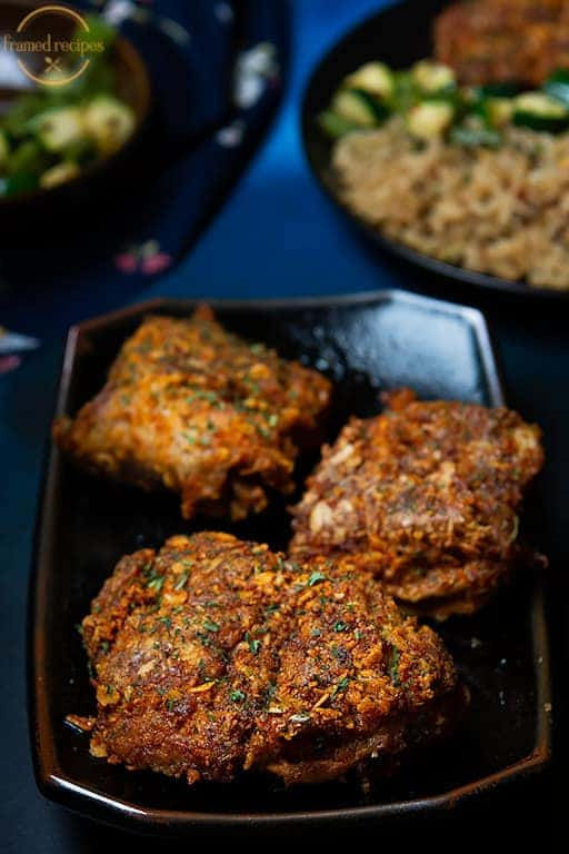 Spicy_Oats_Crusted_Chicken_Thighs_serving_suggestion_of_vegetables_and_rice_vertical_image