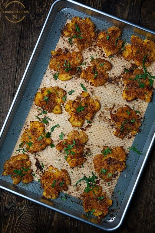Indian_Spiced_Smashed_Potatoes_ina_baking_tray_vertical_image