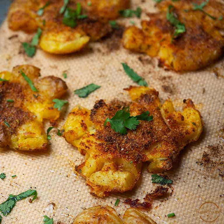 Indian_Spiced_Smashed_Potatoes_close_uo_one-Smashed_potato_square_image