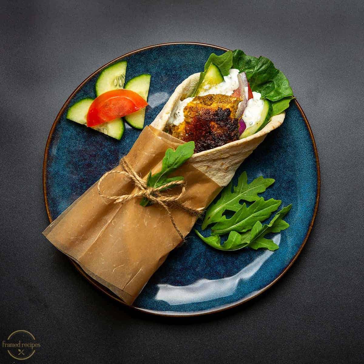 pita wrapped green chutney chicken and tzatziki sauce