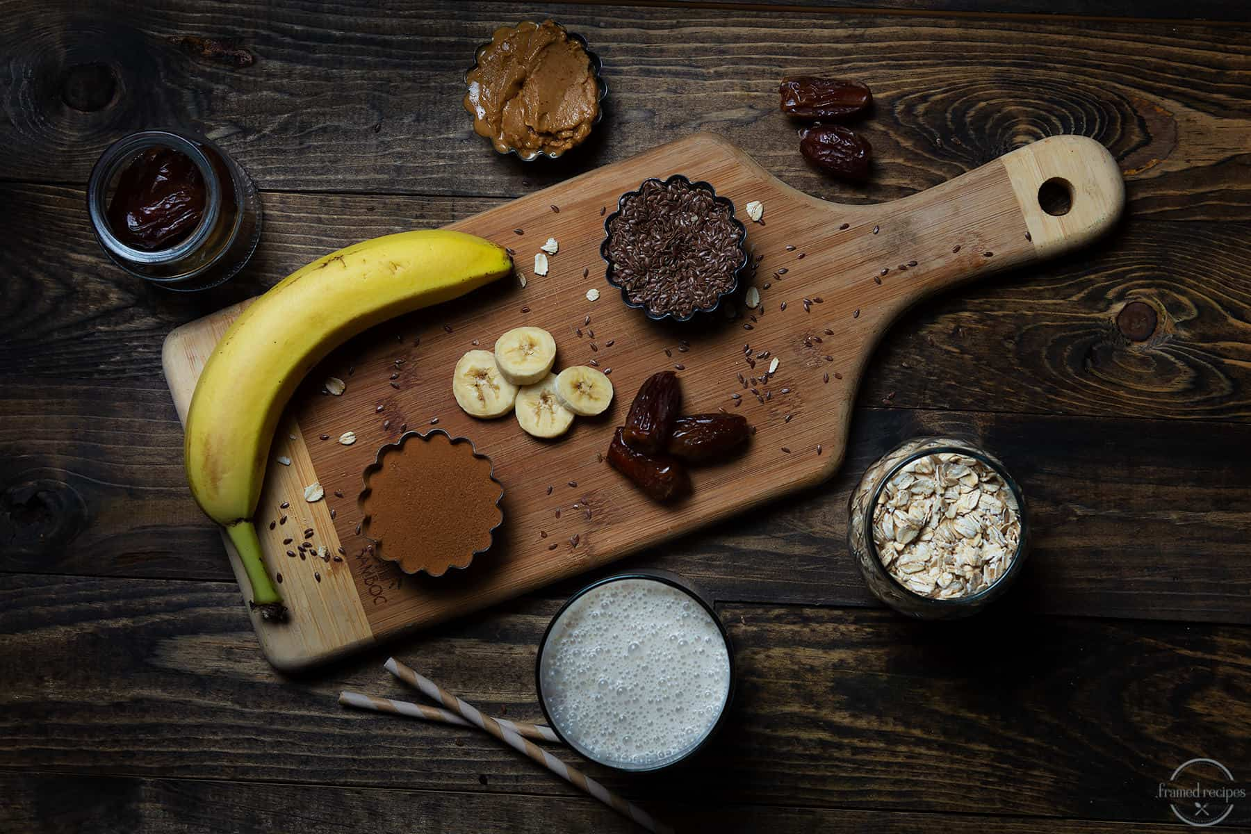 ingredients for roasted peanut butter smoothie - banana, flax seeds, pitted dates, oats, peanut butter & milk.