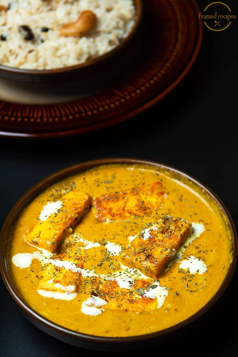a bowl of delicious paneer lehsuni served with cumin flavored rice.