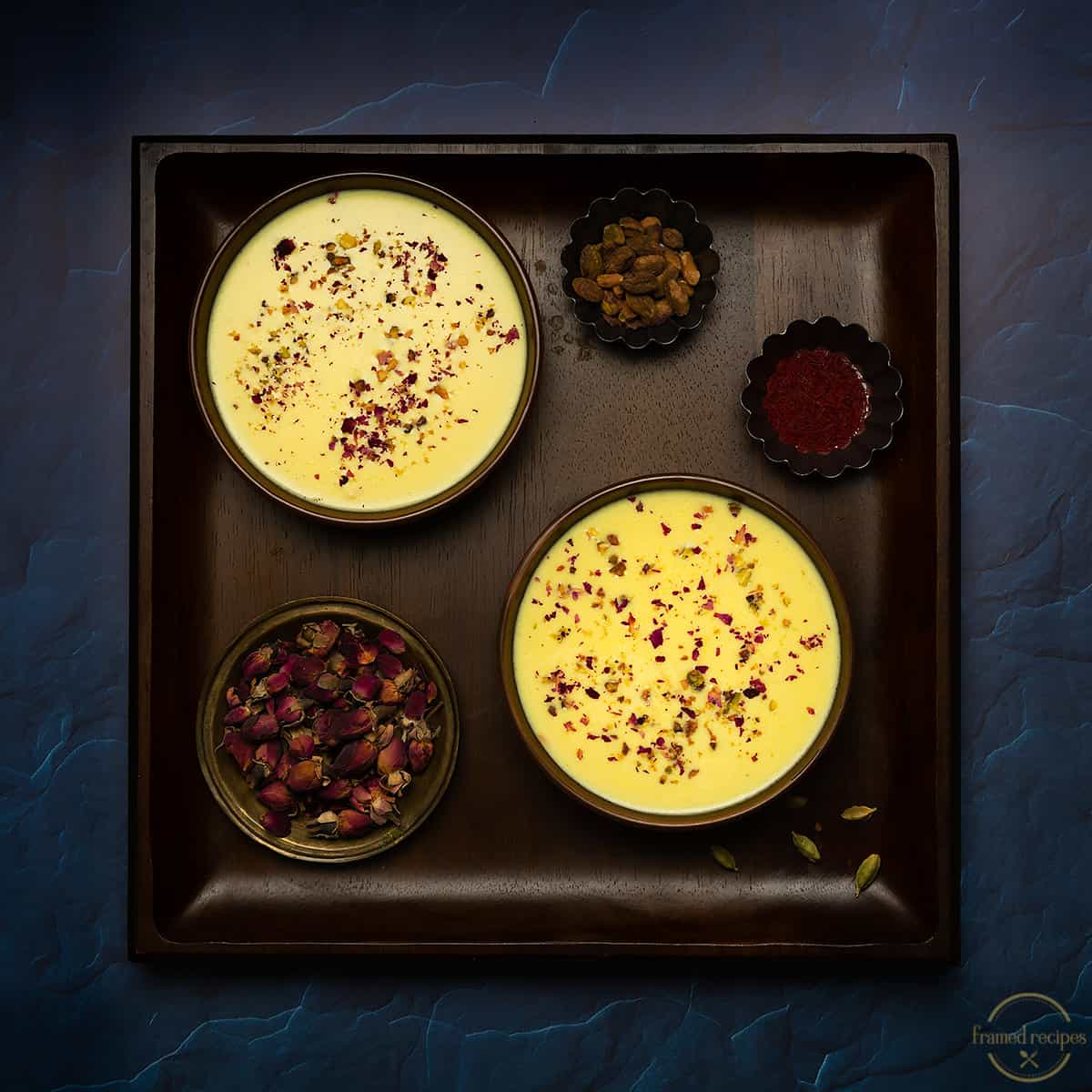 tapioca pear pudding or sabudana kheer garnished with pistachios and rose petals.