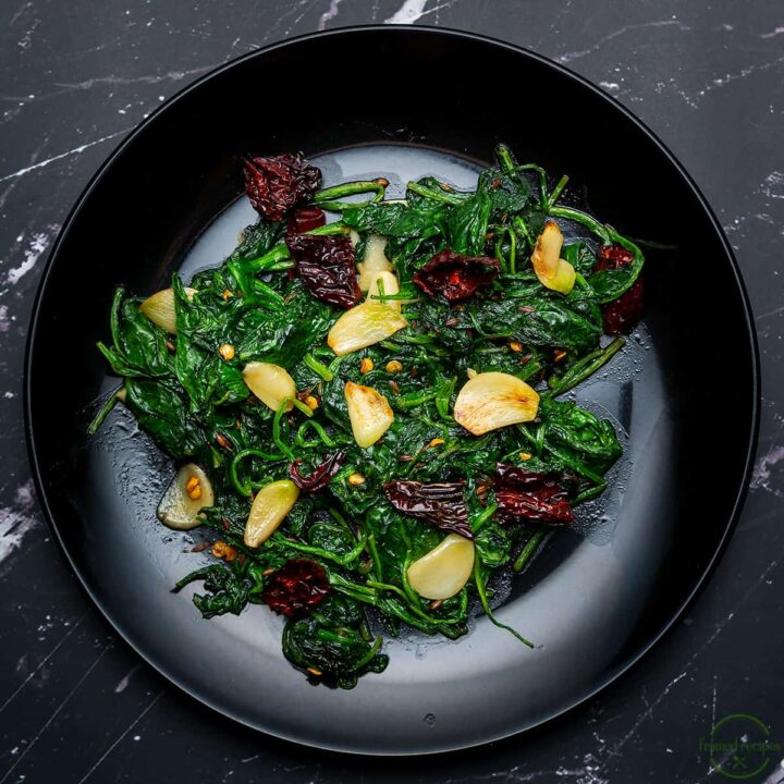 spinach with garlic, cumin and red chillies.