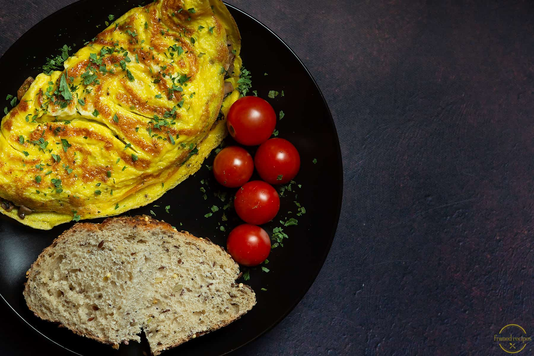 egg omlete served with cherry tomatoes & multi grain bread