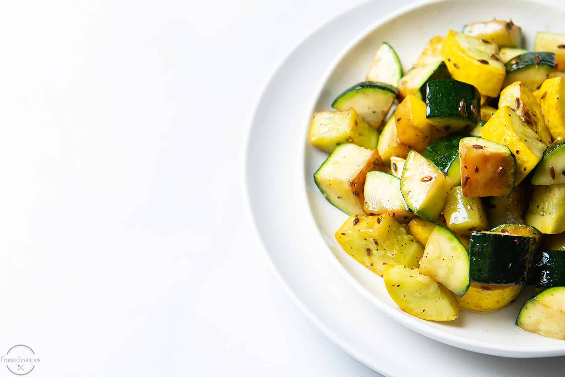 delicious recipe for summer squash seasoned with cumin and black pepper