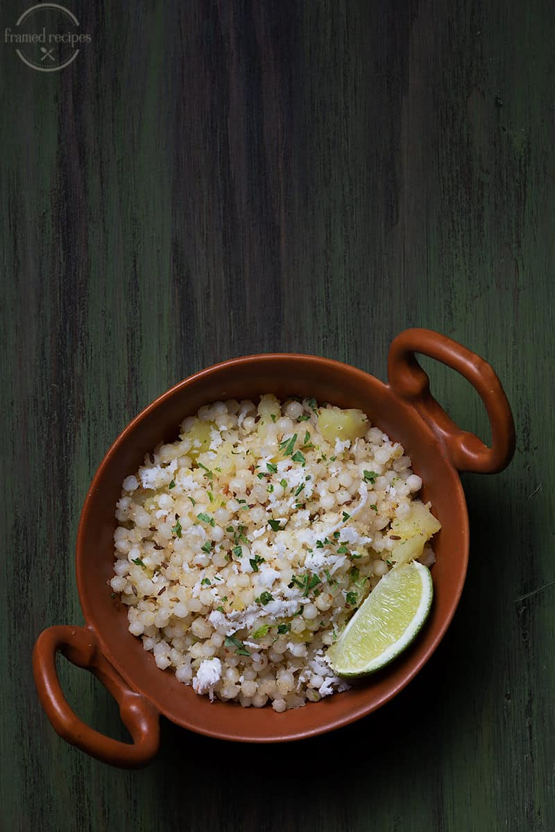 tapioca pearl cooked with spices, peanuts and potatoes garnished with coconut and cilantro served with lemon wedges.